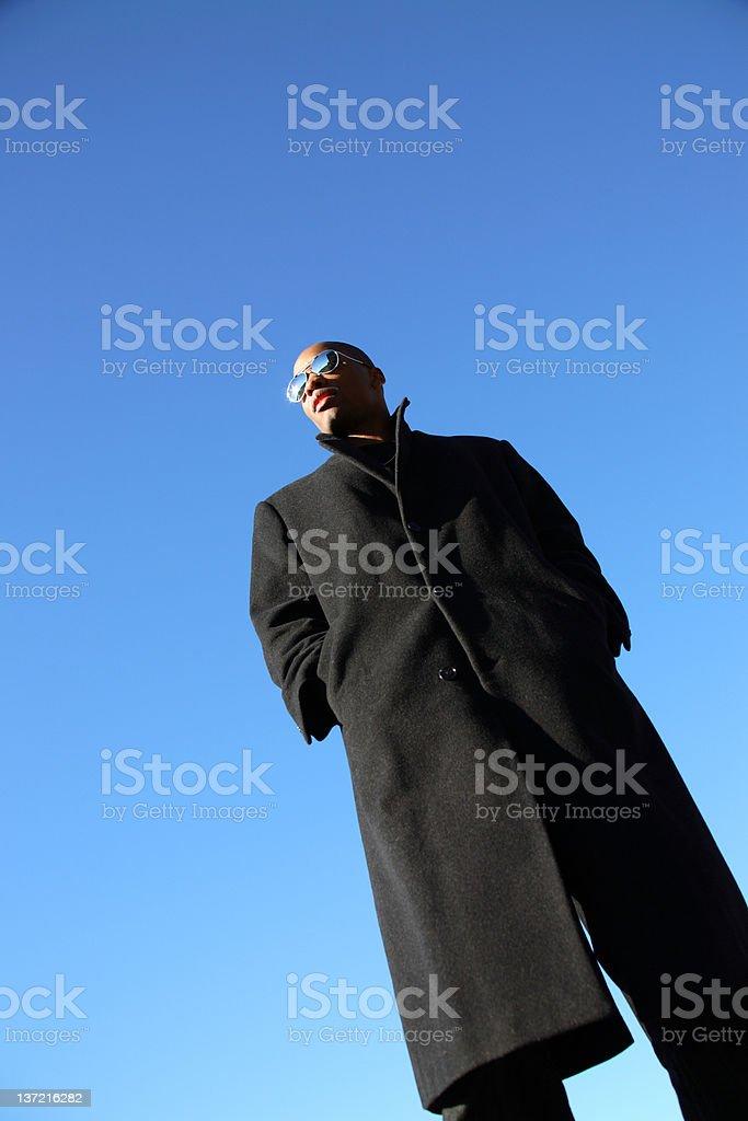 Stylish young man wearing overcoat stock photo