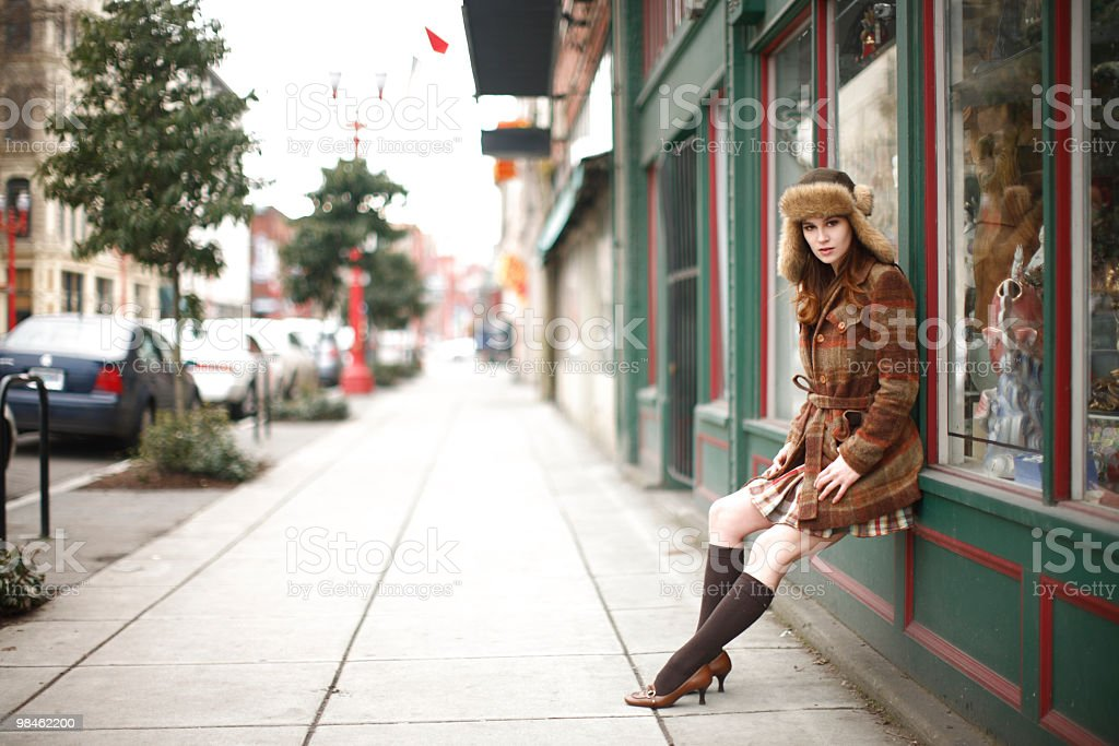 Stylish young woman in city stock photo