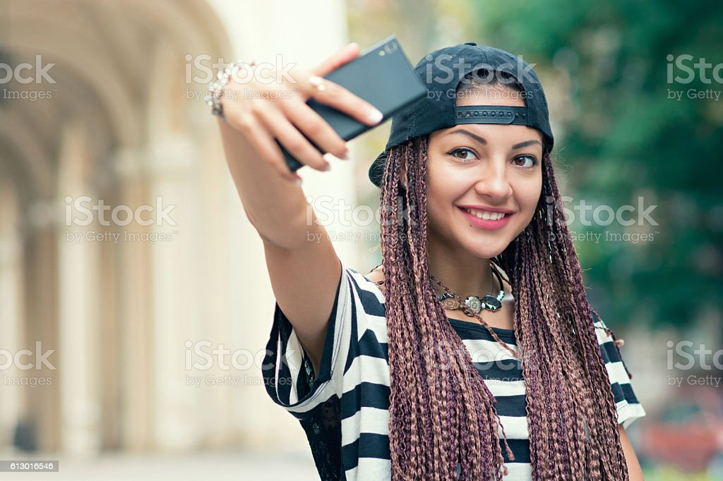 Stylish young woman making selfie at the street stock photo