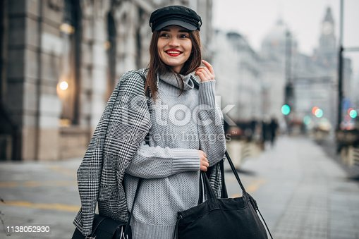 518885222istockphoto Stylish young woman 1138052930