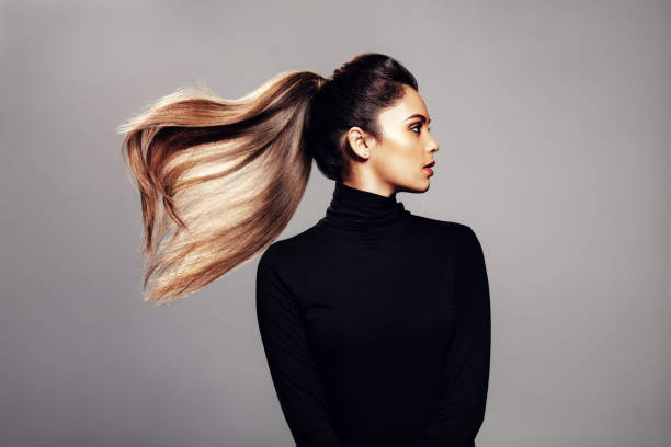 Stylish young woman with flying hair stock photo