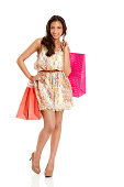 istock Stylish young woman with shopping bag 454136131