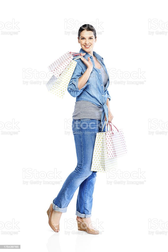 Stylish young woman with shopping bags royalty-free stock photo