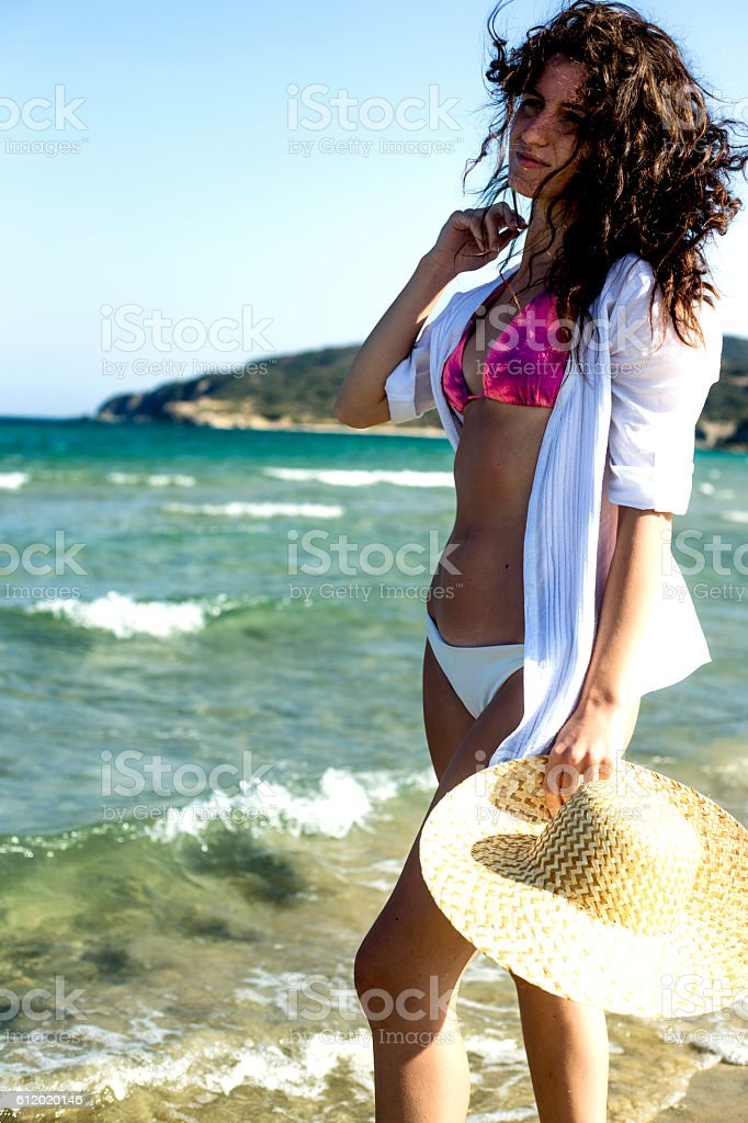 Stylish young women walking on the beah shore stock photo