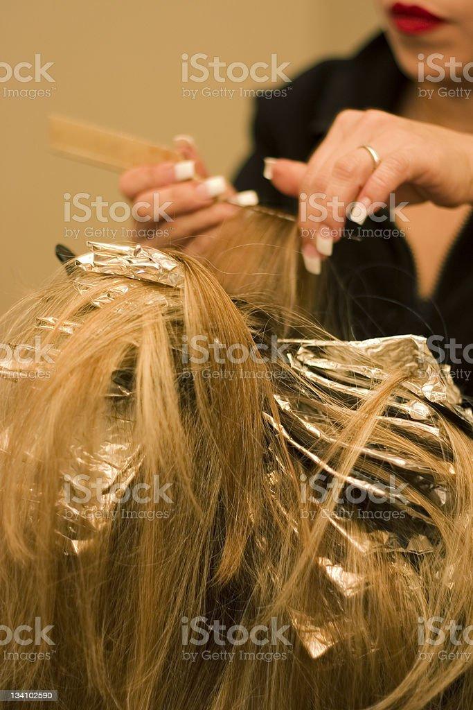Stylist bleaching hair royalty-free stock photo