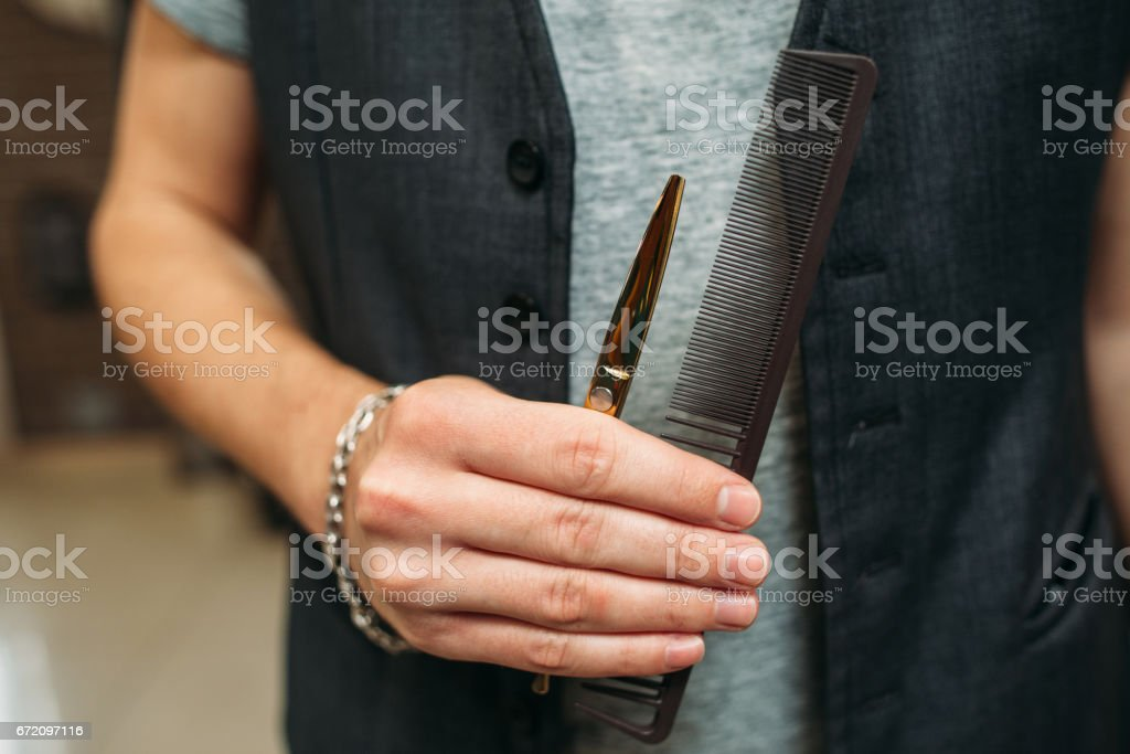 Stylist professional tools in hand closeup stock photo