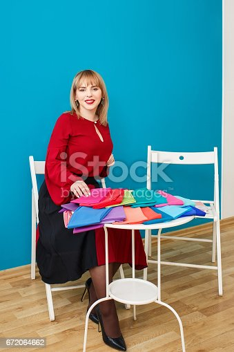 672064598istockphoto stylist with colorful swatches 672064662