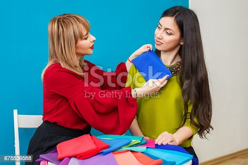 istock stylist working with client 675536588