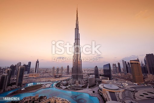A panoramic view of the Dubai city skyline with the Burj Khalifa shown in the center.  The Burj Khalifa is the tallest building in the world.