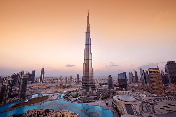 Stylized aerial view of Dubai City A panoramic view of the Dubai city skyline with the Burj Khalifa shown in the center.  The Burj Khalifa is the tallest building in the world. burj khalifa stock pictures, royalty-free photos & images