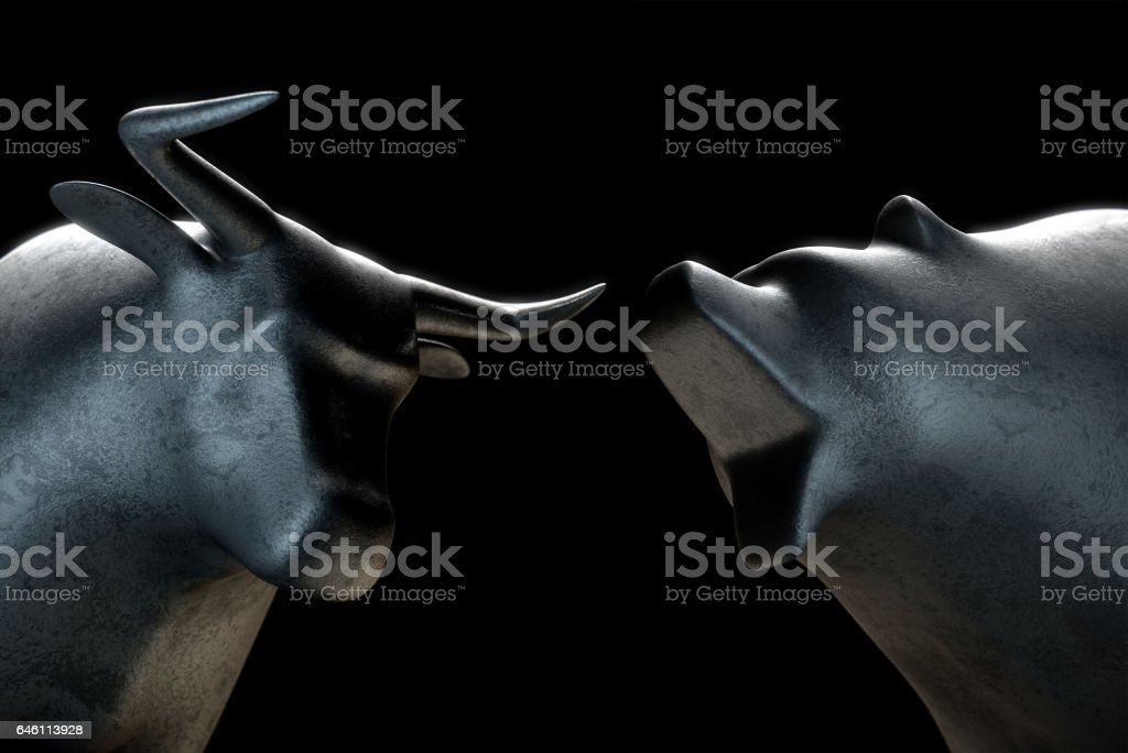 Stylized bull opposing a bear in dramatic light representing  financial market trends stock photo