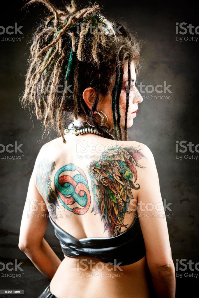 Stylized Grunge Studio Portrait of Alternative Woman stock photo