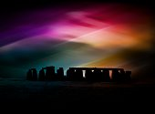 silhouette of ancient standing stones with colourful bokeh layer added