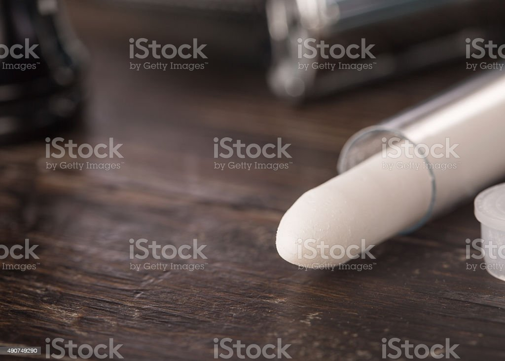 Styptic pencil in clear tube in bathroom setting stock photo
