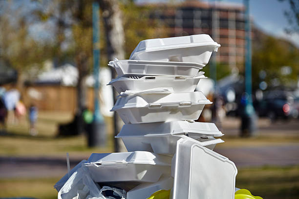 Styrofoam Food Containers White styrofoam used food containers stacked in trash can in park polystyrene stock pictures, royalty-free photos & images