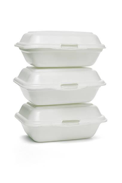 Styrofoam takeaway boxes Stack of Styrofoam takeaway boxes on white background polystyrene stock pictures, royalty-free photos & images