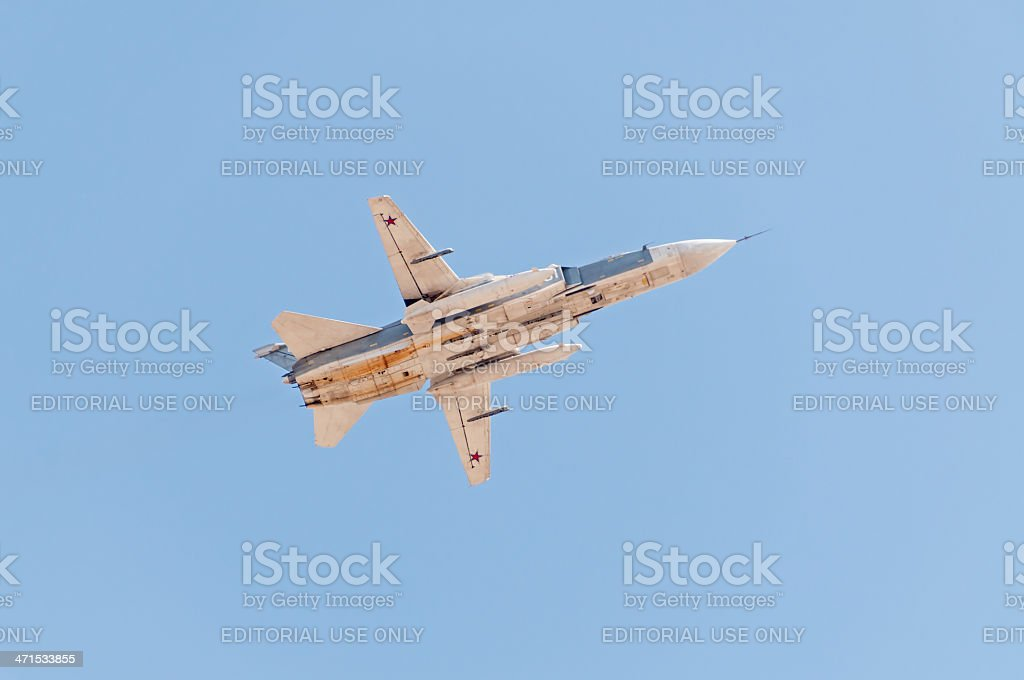 Su-24 supersonic all-weather bomber aircraft flies against blue sky background royalty-free stock photo