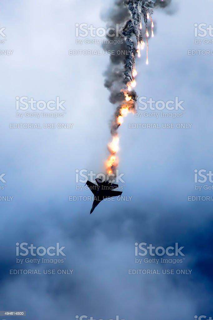 Su-27 performing aerobatics at an airshow stock photo