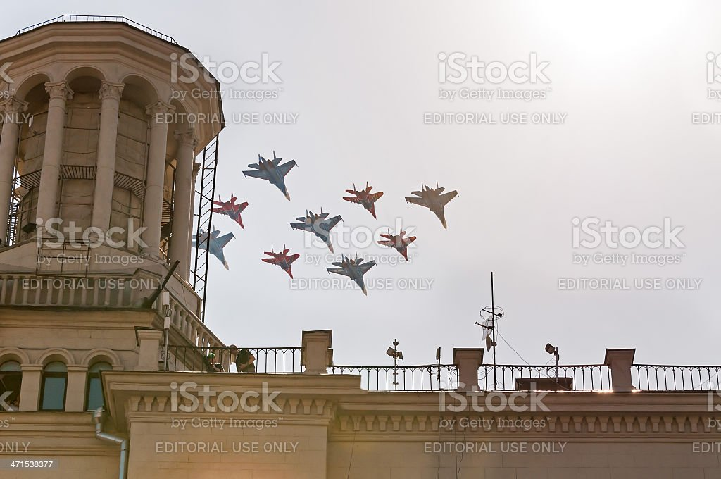 Su-27s and MiG-29UB form unique diamond-shaped figure against sky background royalty-free stock photo
