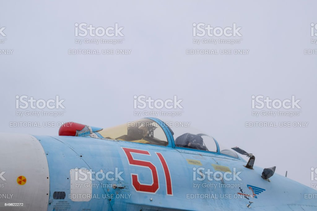 Su-35 fighter at the air show. Aircraft on the airfield to show the audience. The nose of the plane and the cockpit. stock photo