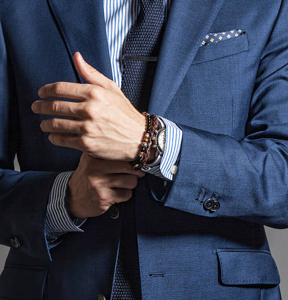 Suave modern man in casual style Suave modern man in casual style with bracelets on hand wristband stock pictures, royalty-free photos & images