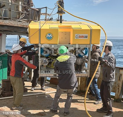 The Bering Sea, Russia - June 2016: Sub Atlantic Comanche ROV (Remotely operated underwater vehicle) placing by scientific team at the deck of RV Akademik M.A. Lavrentyev after the working in abyss