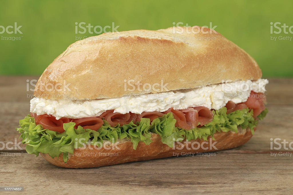 Sub sandwich with smoked salmon royalty-free stock photo