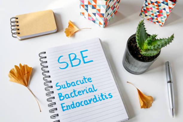 sbe subakute bakterielle endokarditis geschrieben in notebook - arzt zitate stock-fotos und bilder