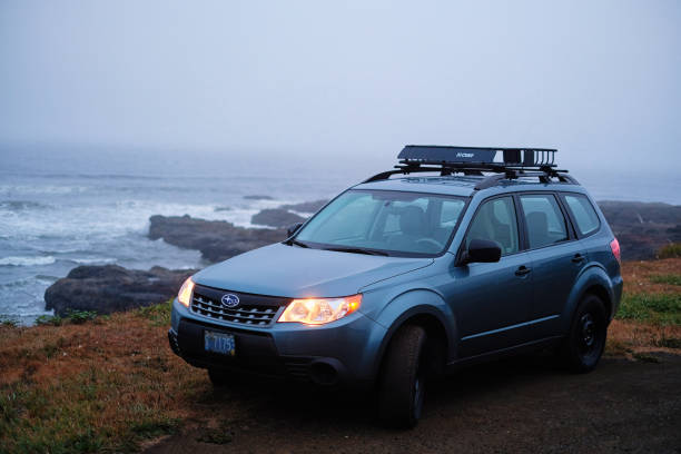 2012 Subaru Forester along Oregon coast August 31, 2017 - Yachats, Oregon, USA: A 2012 Subaru Forester 2.5x on a rocky stretch of the Oregon coast. The all-wheel-drive Subaru Forester is a fuel-efficient small crossover SUV known for its capable handling of off-road terrain. forester stock pictures, royalty-free photos & images