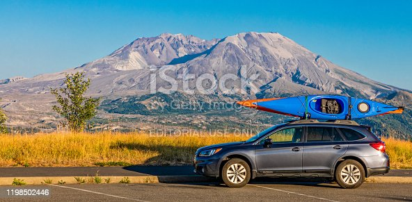 Mt. St. Helens, Washington, August 1, 2018, Subaru with Kayaks on top in front of Mt. St. Helens at Sunset