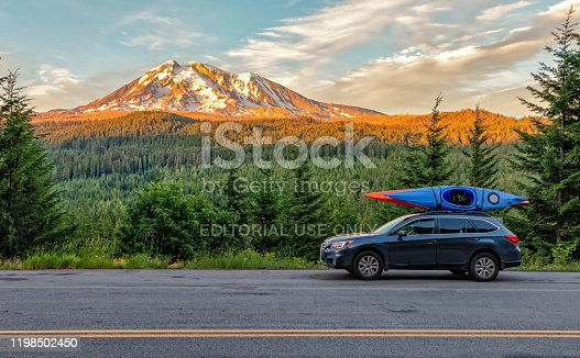 Gifford Pinchot National Forest, Washington - July 13, 2018:  SUV with Kayaks in front of Mt. Adams at sunset