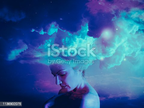 Conceptual photo compilation of woman portrait with clouds and stars