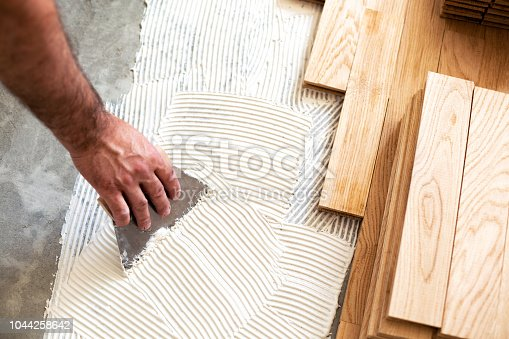 922081754istockphoto Subfloor creation for parquet floor assembly 1044258642