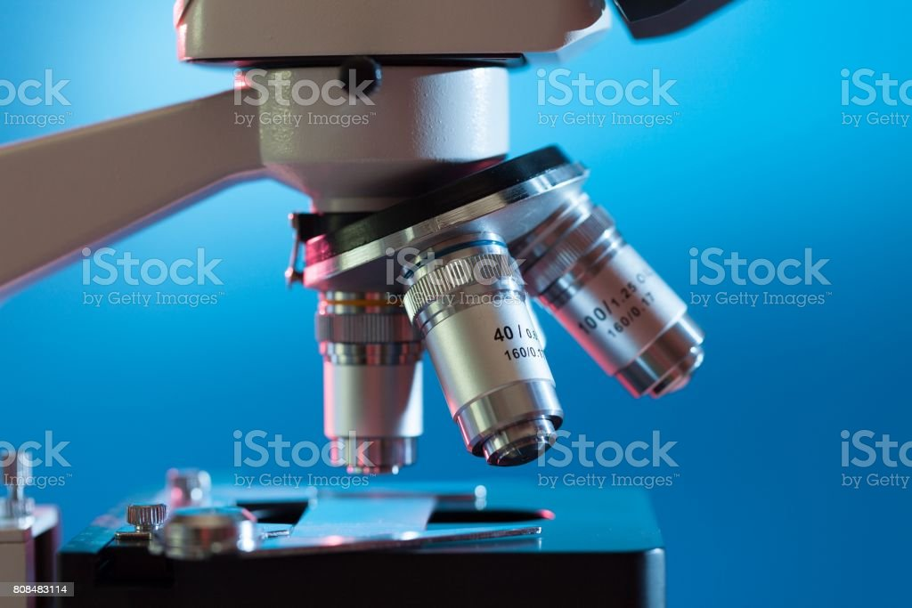 Subject table microscope and interchangeable lenses. Microscope stock photo