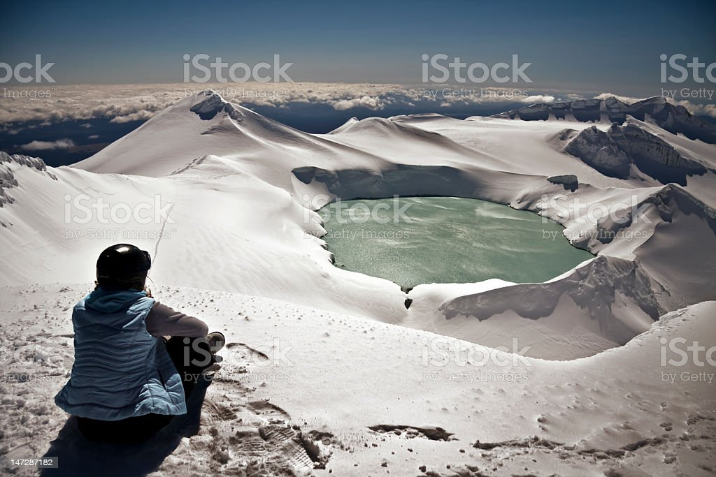 Sublime view of crater lake sitting on mountain top stock photo
