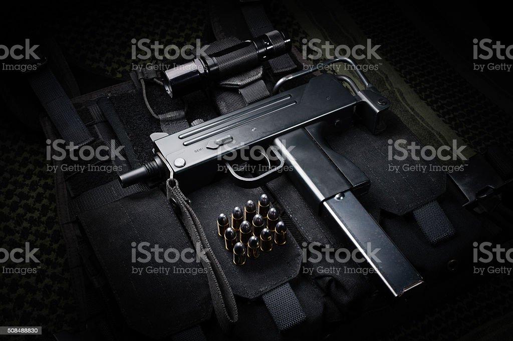 Submachine gun and 9mm round stock photo