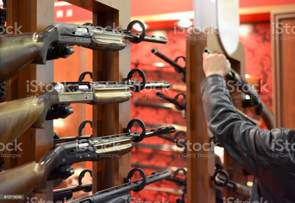 Submachine Gun on the wall Submachine Gun on the wood wall close-up Aggression Stock Photo