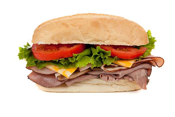 submarine sandwich auf weiß - roast beef sandwich stock-fotos und bilder