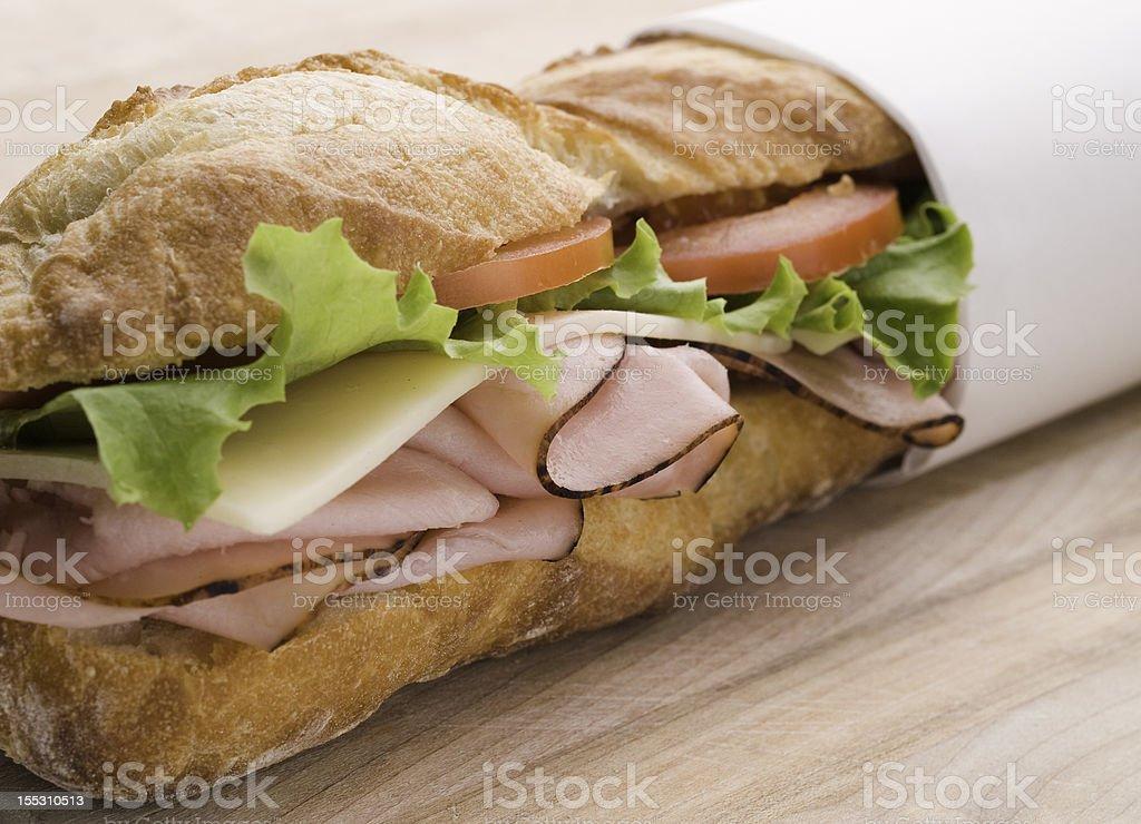 submarine sandwich on wood stock photo