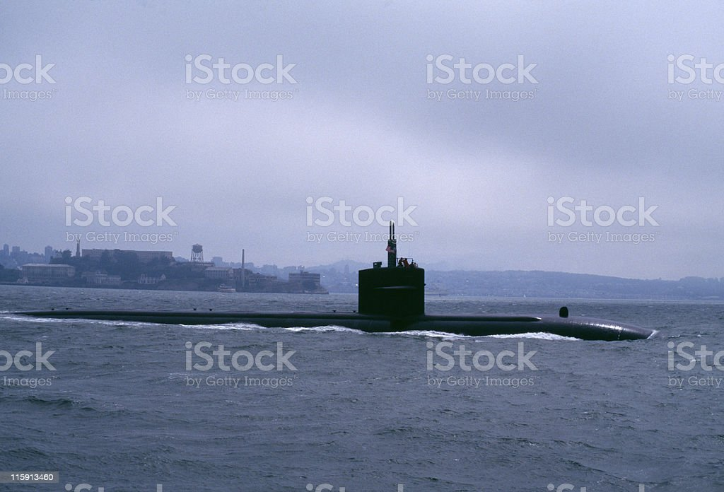 submarine slipping out to sea under fog San Francisco Bay stock photo