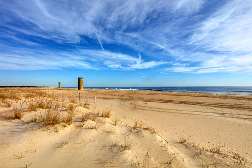 Cape Henlopen is the southern cape of the Delaware Bay along the Atlantic coast of the United States. Submarine Towers were set up along the coast as baselines to triangulate the position of suspicious ships or submarines. Five such towers still exist within the current boundaries of Cape Henlopen