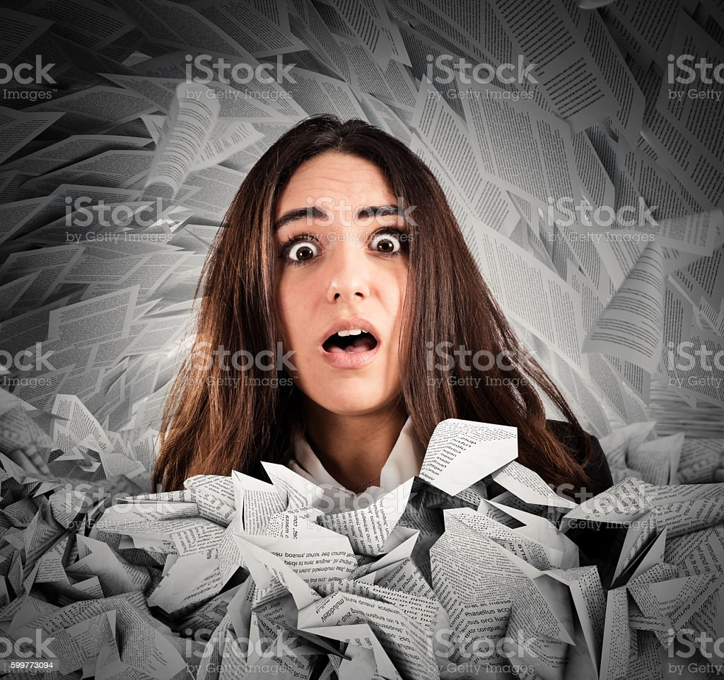 Submerged by the working documents stock photo