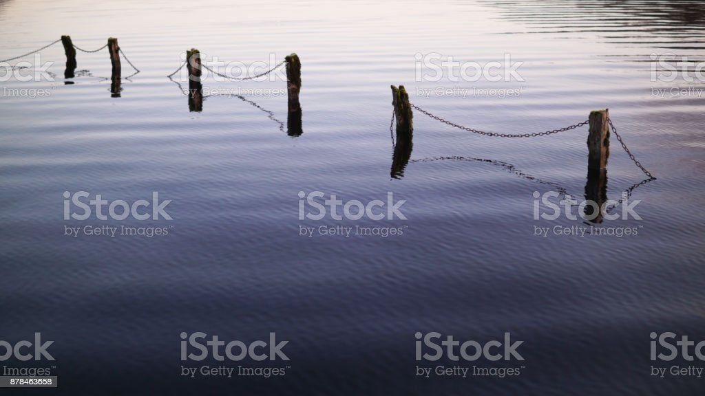 Submerged Fence 2 stock photo