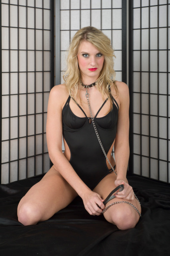 Submissive Young Blond Woman With Collar And Leash Stock