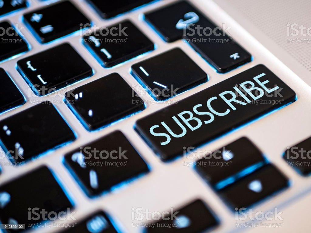 subscribe button in the laptop keyboard close up stock photo