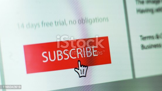 """Stock close up image showing a """"subscribe"""" button on a website with hand shaped cursor"""