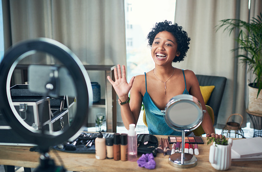 Shot of a influencer recording a makeup tutorial for her blog at home
