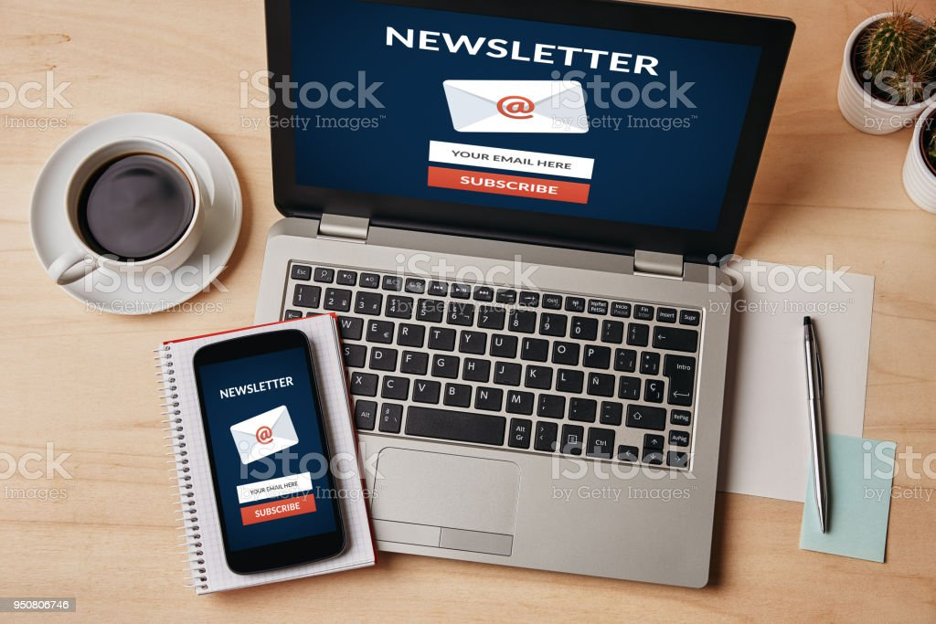 Subscribe newsletter concept on laptop and smartphone screen stock photo