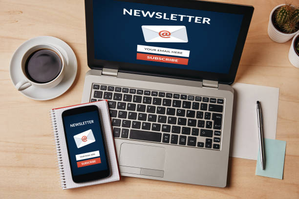 Subscribe newsletter concept on laptop and smartphone screen Subscribe newsletter concept on laptop and smartphone screen over wooden table. All screen content is designed by me. Flat lay newsletter stock pictures, royalty-free photos & images