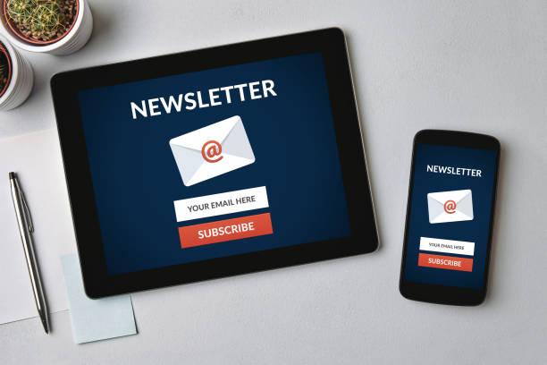 Subscribe newsletter concept on tablet and smartphone screen Subscribe newsletter concept on tablet and smartphone screen over gray table. All screen content is designed by me. Flat lay newsletter stock pictures, royalty-free photos & images